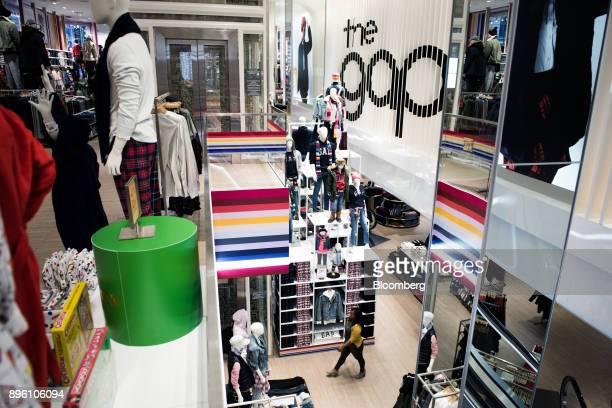 ddb85486713 A customer walks through a Gap Inc store in New York US on Wednesday Dec 13