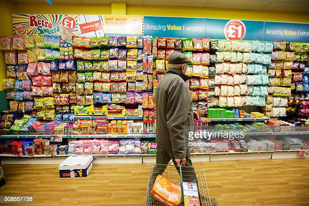 A customer walks through a Poundland Group Plc store in Leigh UK on Thursday Feb 4 2016 UK like for like sales at midmarket retailers rose 14 percent...