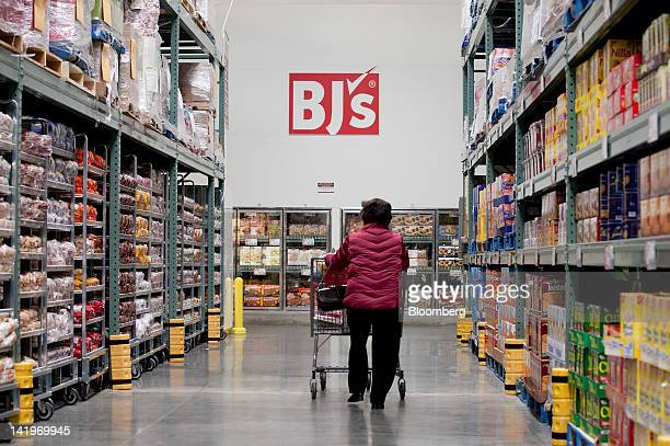 A customer walks through an aisle of a BJ's Wholesale Club Inc store in Falls Church Virginia US on Tuesday March 27 2012 The US Bureau of Economic...