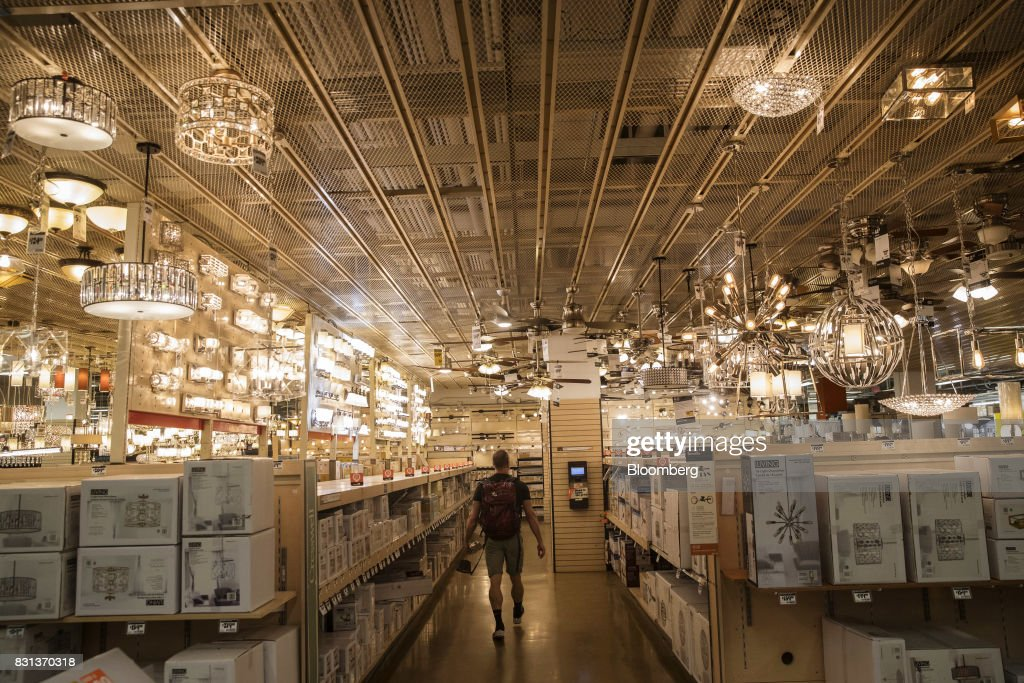 A Customer Walks Through The Lighting Department At Home