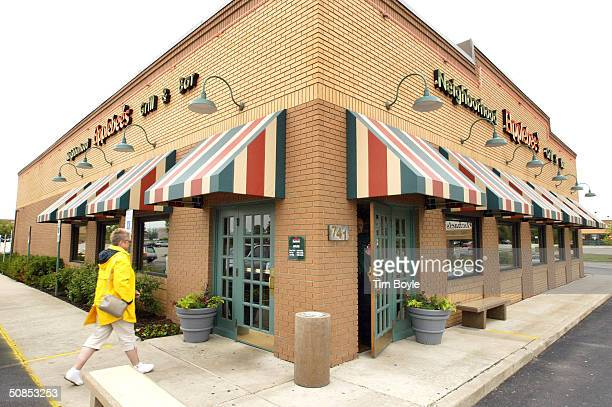 A customer walks towards an entrance to an Applebee's restaurant May 18 2004 in Palatine Illinois Applebee's has introduced new Weight Watchers items...