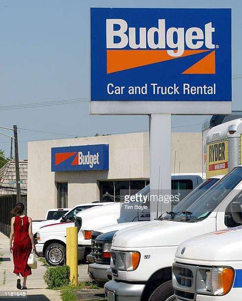 Customer walks towards the Budget car and truck rental office July 30, 2002 in Park Ridge, Illinois. Budget Group Inc., which owns the world's...