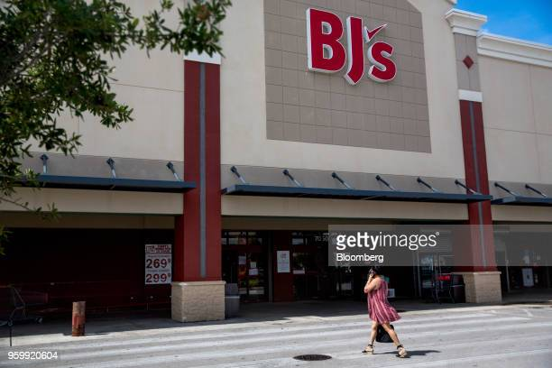A customer walks towards the entrance of a BJ's Wholesale Club Holdings Inc location in Miami Florida US on Friday May 18 2018 The warehouseclub...