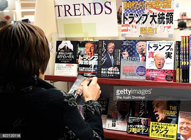 A customer watches books on presidentialelect Donald Trump at Yaesu Book Center on November 10 2016 in Tokyo Japan Donald Trump won the 2016...