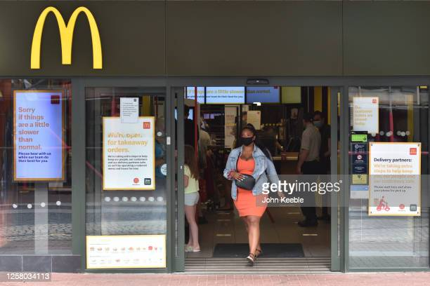 Customer wearing a face mask walks out of a McDonalds restaurant on July 24, 2020 in Southend on Sea, England. From today, consumers in the United...