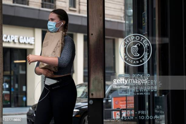 A customer wearing a protective mask exits a Chipotle Mexican Grill Inc restaurant in San Francisco California US on Monday July 20 2020 Chipotle is...