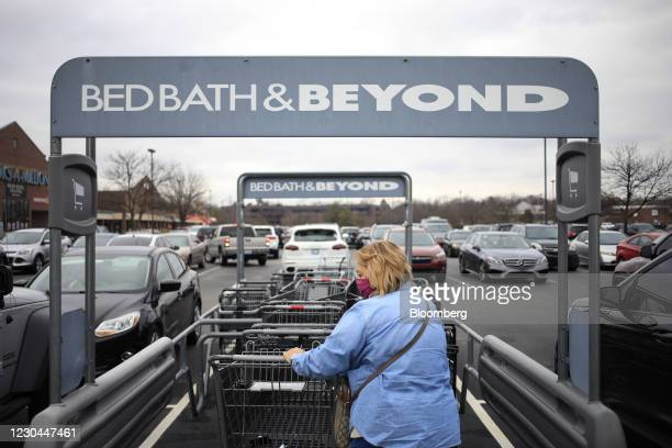 Customer wearing a protective mask retrieves a shopping cart outside a Bed Bath & Beyond store in Louisville, Kentucky, U.S., on Saturday, Jan. 2,...