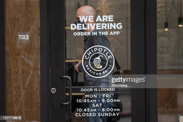 A customer wearing a protective masks exits a Chipotle Mexican Grill Inc restaurant in San Francisco California US on Monday July 20 2020 Chipotle is...