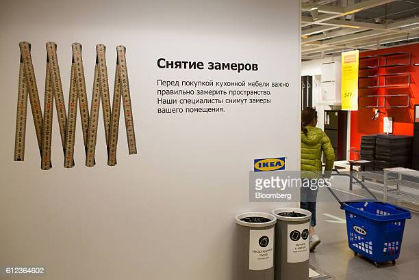 A customer wheels a trolley basket through the Ikea AB retail store in Khimki Russia on Monday Oct 3 2016 Ikea's Russia unit may spend 100 billion...