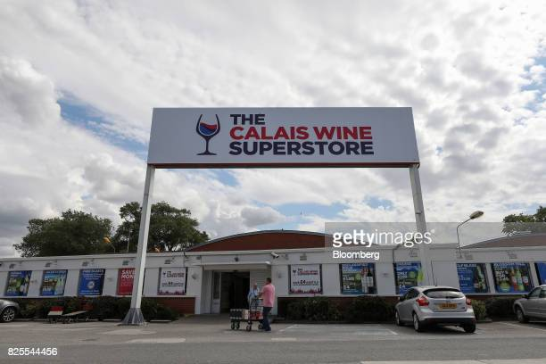 A customer wheels a trolley of wine from The Calais Wine Superstore in Calais France on Tuesday Aug 1 2017 Customs checks at the border after the UK...