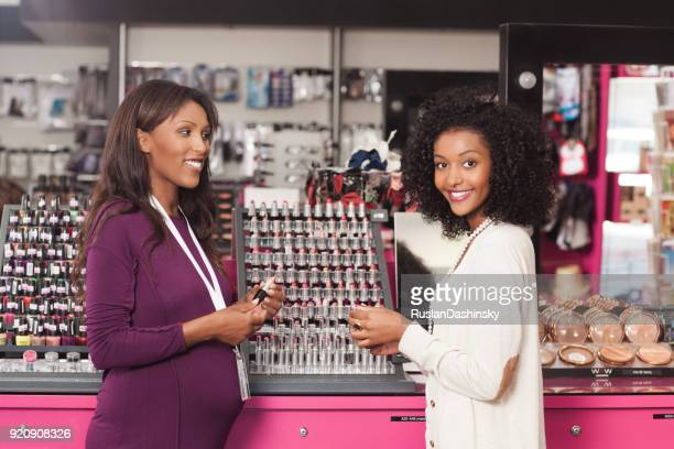 customer with a beauty consultant. - beautiful israeli women stock pictures, royalty-free photos & images