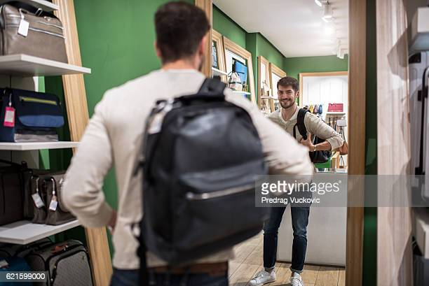 Customer with backpack in the store
