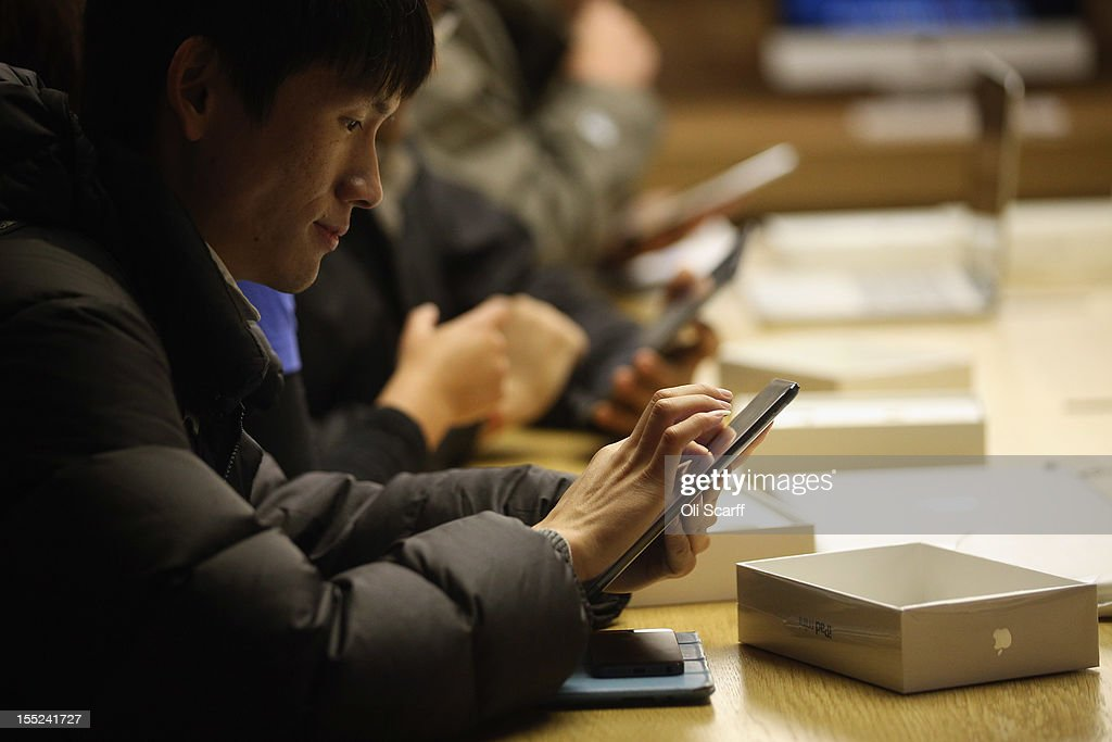 Customer Yu Liu sets up his new 'iPad mini' on the morning of the tablet's launch in the Apple Store in Covent Garden on November 2, 2012 in London, England. Customers have queued outside Apple Store branches around the world to be some of the first people to purchase the new smaller iPad tablet computer; the screen on which measures 7.9 inches diagonally compared to 9.7 inches for a regular iPad.