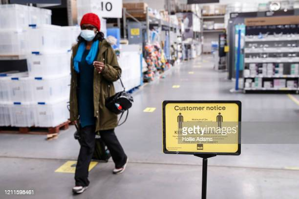 Customers abide by social distancing measures at B&Q Leyton on May 2, 2020 in East London, United Kingdom. British Prime Minister Boris Johnson, who...