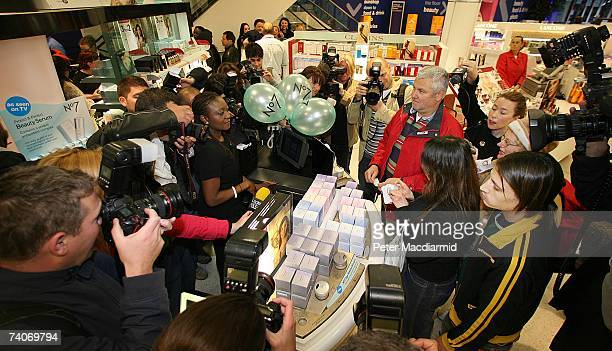 Customers and media line up at the tills at Boots the Chemist May 4 2007 in London Boots opened four of it's larger stores at 7am to allow customers...
