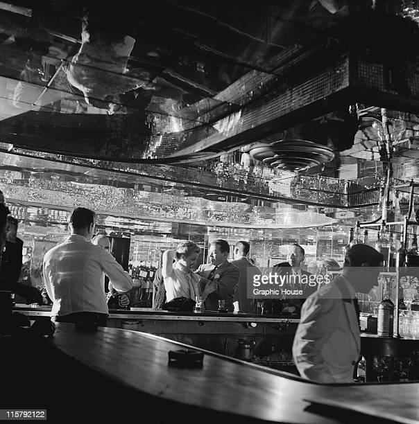 Customers and staff at the bar of the Latin Quarter nightclub Times Square New York City 1951
