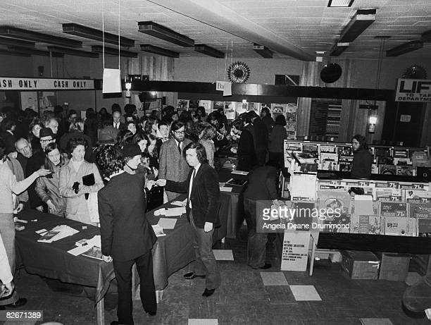 Customers and staff at the HMV shop in Oxford Street London during a powercut 19th December 1973 Power cuts intended to conserve fuel during the...