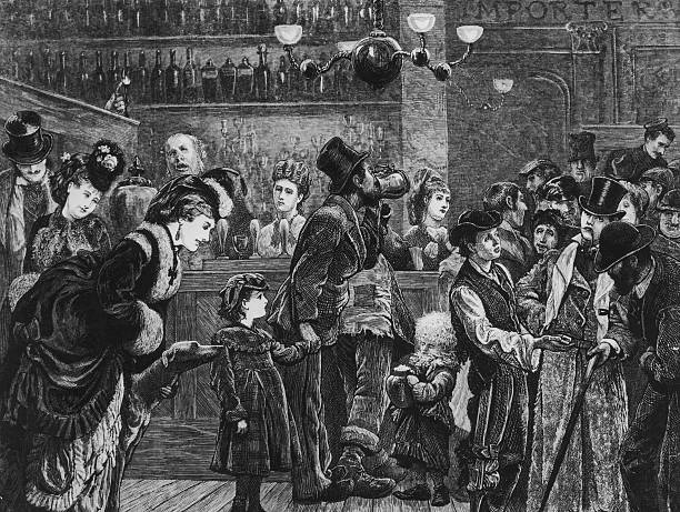 Customers and staff in a London pub, circa 1870.