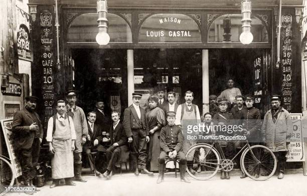 Customers and staff of the Maison Louis Gastal a store front and cafe in Paris circa 1910