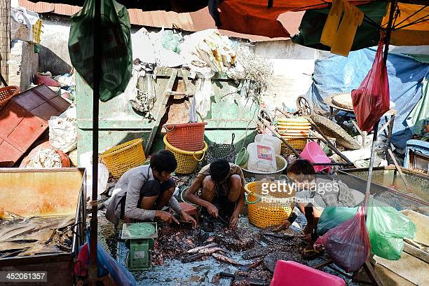 Customers and traders start very early in the morning in a wet market on November 26 2013 in Siem Reap Cambodia Cambodian continues their daily life...