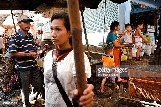 Customers and traders walk in a wet market on November 26 2013 in Siem Reap Cambodia Cambodian continues their daily life despite a controversial...