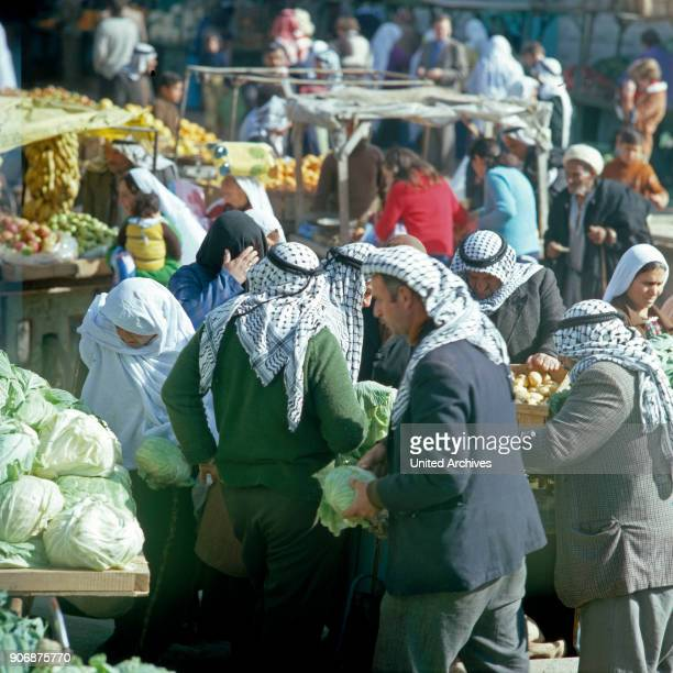 Customers and vendors on the bedouin market at Beer Sheba Israel late 1970s