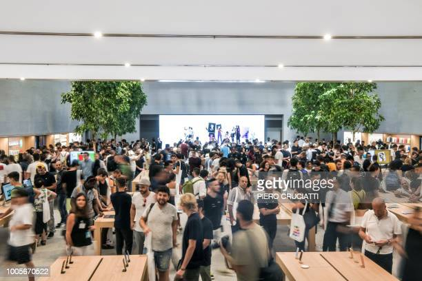 Customers are inside the new Apple Store Liberty the first Italian flagship store of Apple in Milan on July 26 2018