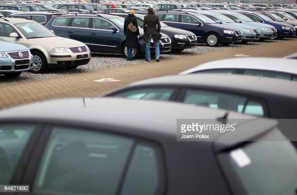 b04614dea1 Customers are looking for a new car at a car dealer on February 4 2009 in
