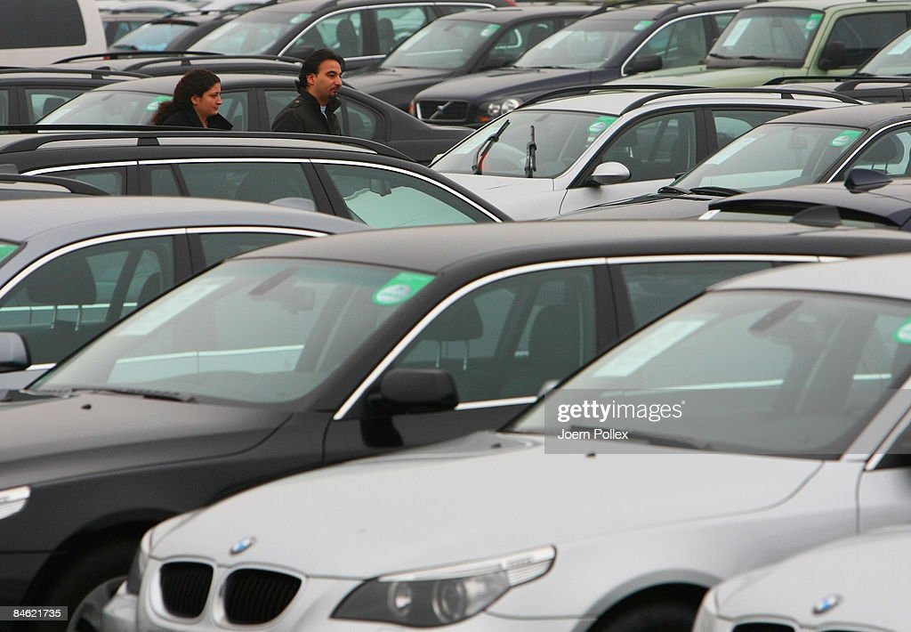 7309d82b90 Customers are looking for a new car at a car dealer on February 4 ...