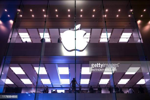 Customers are pictured inside the Apple shop in Hong Kong on October 30 a day before the citys third-quarter gross domestic product figures are...