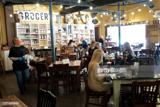 Customers are seen at Puckett's Grocery Restaurant on April 27 2020 in Franklin Tennessee Tennessee is one of the first states to reopen restaurants...