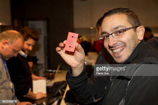 Customers are seen at the cashier of 'Nous' new concept storeThey are the first to acquire the special edition 'Sandstone'One Plus Five smart phone...