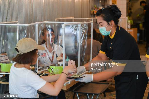 Customers are seen eating in ShabuShabu restaurant as a preventive social distancing measure at Penguin Eat Shabu on May 5 2020 in Bangkok Thailand...