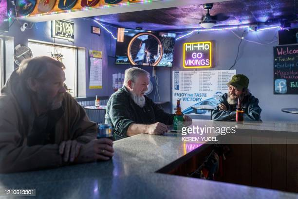 Customers are seen inside an open bar practicing social distancing during the coronavirus COVID19 pandemic on April 20 in Sioux Falls South Dakota...