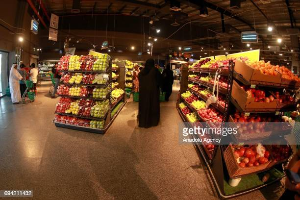 Customers are seen shopping at Al Meera market in Doha Qatar on June 9 2017 People only rushed to markets and stocked food until the shelves were...