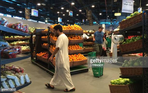 Customers are seen shopping at the alMeera market in the Qatari capital Doha on June 10 2017 Saudi Arabia Egypt the UAE and Bahrain announced on June...