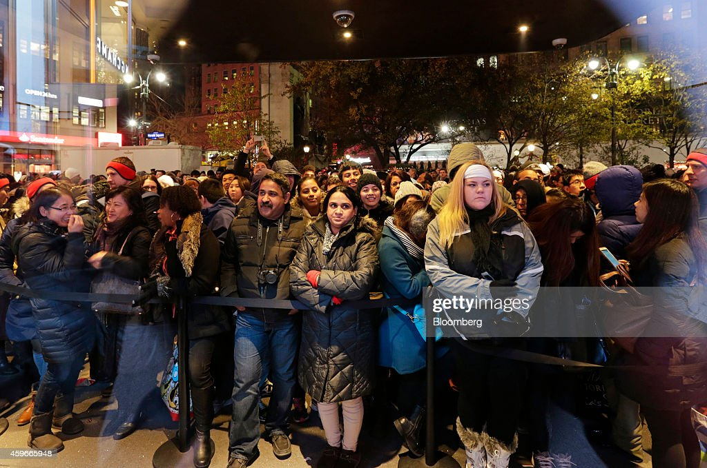 Shoppers Inside Macy's Inc. And Toys R Us Inc. Stores Ahead Of Black Friday Sales : News Photo