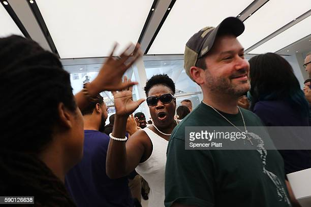 Customers are welcomed at the new Apple Store at the 350000 squarefoot Westfield World Trade Center shopping mall at the Oculus on opening day on...
