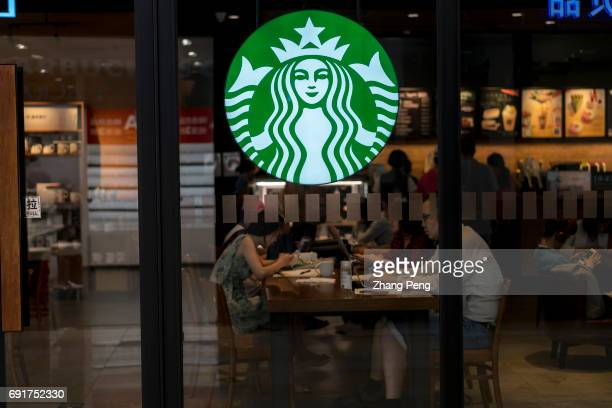 Customers are working on laptop in a Starbucks coffee shop In the second quarter of 2017 Starbucks opened its stores to five new cities in China As...