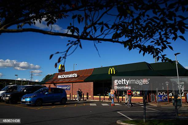 Customers arrive at a McDonald's Corp restaurant in Manchester UK on Monday Aug 10 2015 McDonald's Chief Executive Officer Steve Easterbrook...