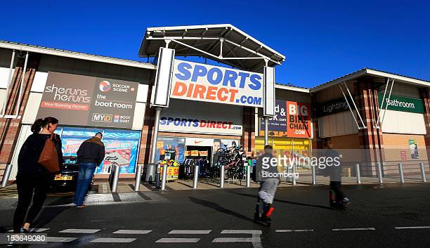 Customers arrive at a Sports Direct International Plc store in Urmston UK on Saturday Oct 6 2012 JJB Sports Plc a UK sporting goods retailer will...