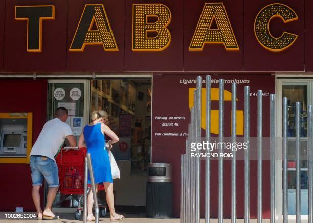 Customers arrive at a 'tabac' in Perthus a small town on the FrenchSpanish border on July 20 2018 The regional chamber of accounts for Occitanie has...