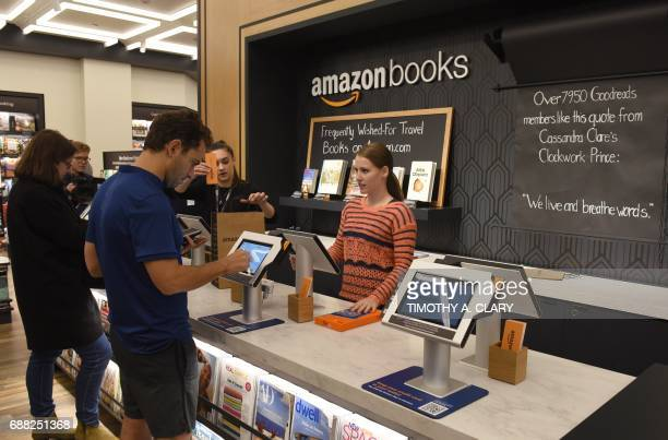 Customers arrive at Amazon Books in Manhattan's Time Warner Center on May 25 2017 as the online retailing giant Amazoncom Inc opens its first New...