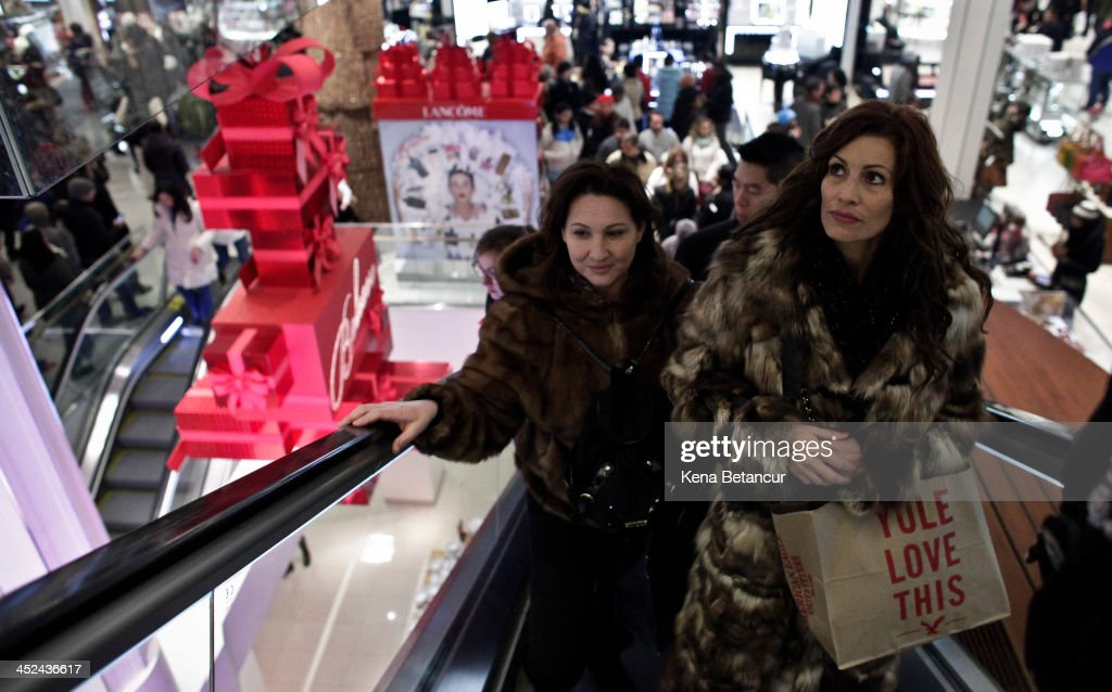 Customers ascend the escalator at Macy's Herald Square after the store opened its doors at 8 pm Thanksgiving day on November 28, 2013 in New York City. Black Friday shopping began early again this year with most major retailers opening their doors on Thanksgiving day.