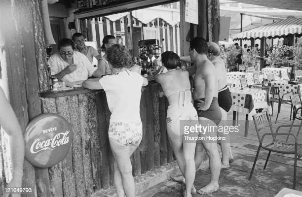 Customers at a bar on Paraggi Beach near the tourist resort of Portofino Italy August 1952 Original Publication Picture Post 6023 unpub