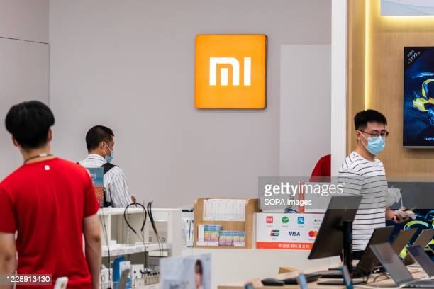 Customers at a Chinese electronics company Xiaomi store.