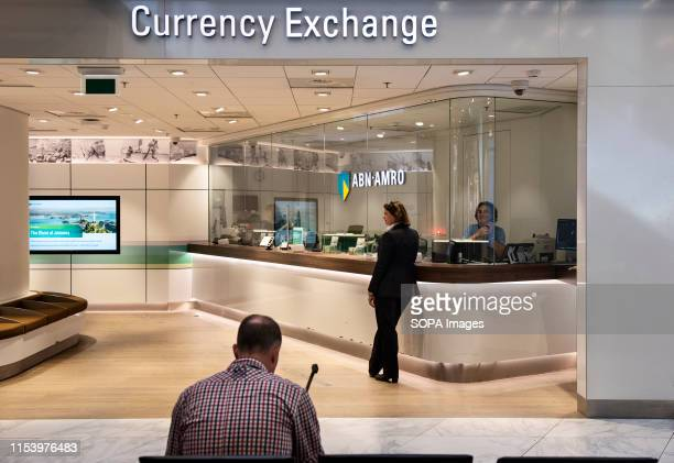 Customers at a currency exchange and money change company at the Amsterdam Schiphol Airport