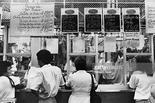 Customers at a delicatessen stall at a market in San Jose Costa Rica January 1989