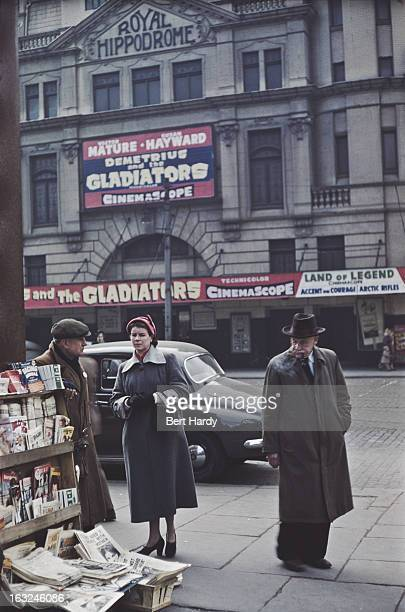 Customers at a news stand opposite the Royal Hippodrome cinema Victoria Street Belfast Northern Ireland June 1955 The cinema is showing 'Demetrius...