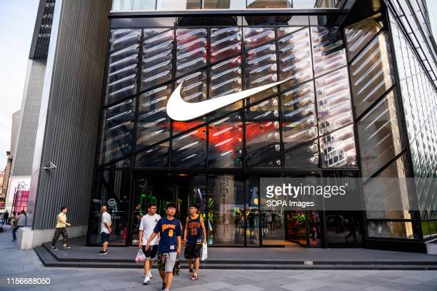 Customers at an American multinational sportswear corporation Nike store seen in Shanghai.